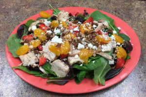 Natalie's salad with chicken, oranges, walnuts and strawberry vinaigrette.